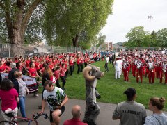 High school bands and cheer squads warming up